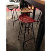 Used red industrial stool
